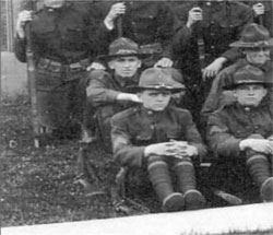 Photo of Davenport High School ROTC members watching a performance at the Armistice Day parade of 1920