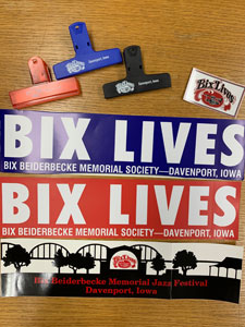 Image of Bix Jazz Society chip-clips, magnet, and bumper stickers in red, black, and blue designs